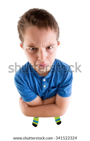 Young Boy Looking at the Camera From High Angle View with Mean Facial Expression. Isolated on White Background.
