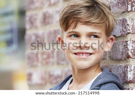 Young boy looking away, close up  - stock photo