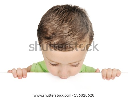 Young boy looking down over white blank sign - stock photo