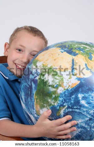 Young boy loving the earth