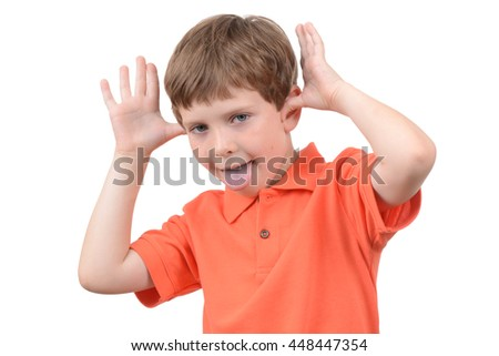 young boy making a face isolated white background
