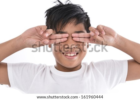 young boy making a funny face, - stock photo