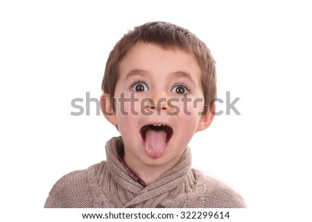 young boy making a silly face - stock photo