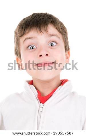 Young boy making faces isolated in white