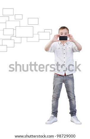 Young boy making photos with mobile device, isolated on white, clipping path - stock photo