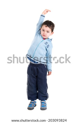Young boy measuring his height isolated in white - stock photo