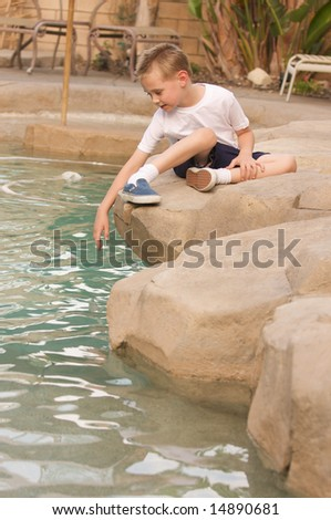 Young Boy Near Swimming Pool - stock photo