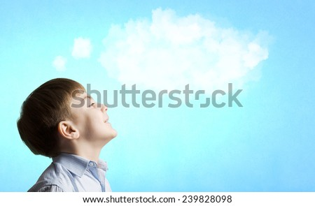 Young boy of school thinking about something - stock photo