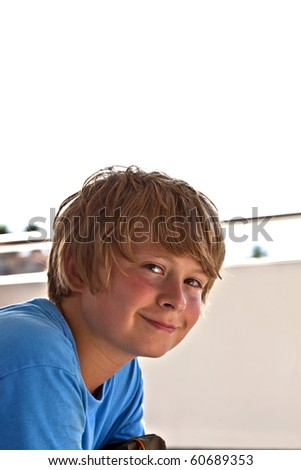 young boy on a boattour smiles and looks confident