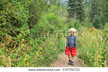 Young boy on a hike in the Utah mountains, USA.