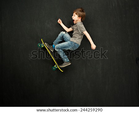 Young boy on a skateboard - stock photo