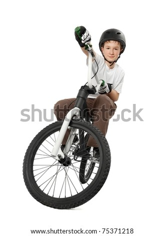 Young boy on bicycle, isolated on white - stock photo