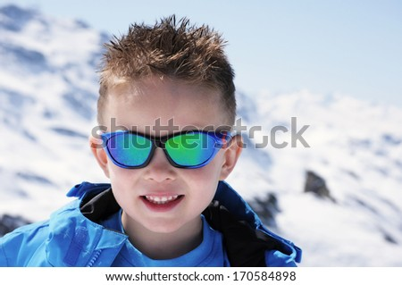 Young boy on mountain - stock photo