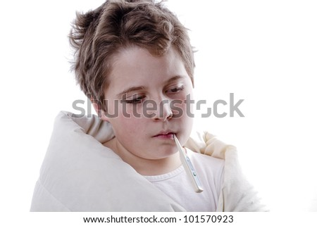 Young boy patient with fever, with digital thermometer and white blanketand flu