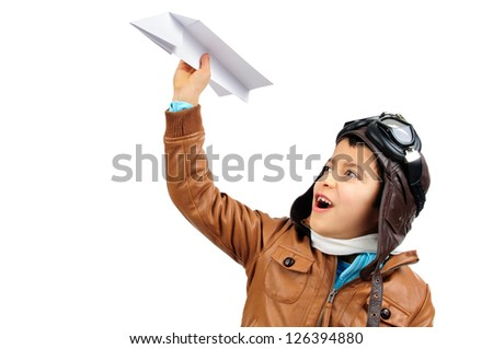 Young boy pilot with a paper plane isolated in white - stock photo