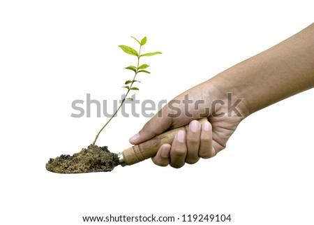 Young boy plant in hand against green nature background.