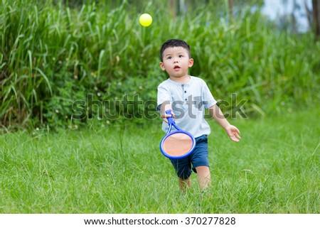 Young boy play tennis  - stock photo
