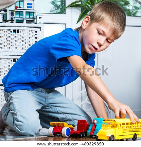 Young boy play with cars