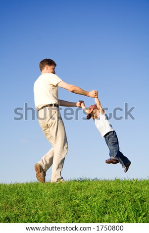 Young boy play with father - motion blur - stock photo