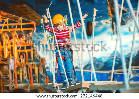Young boy playing and having fun doing activities outdoors. Happiness and happy childhood concept - stock photo