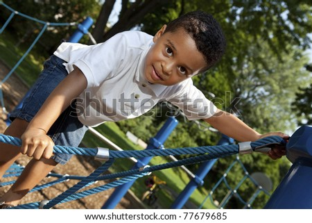 Young boy playing at a park - stock photo