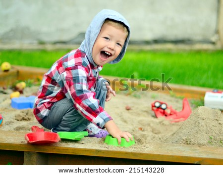 Young boy playing in the sandbox