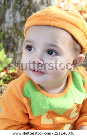 Young boy playing outside on pebble beach - stock photo