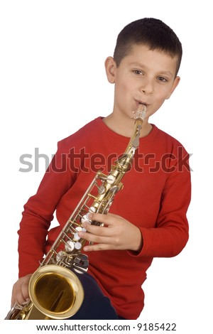 Young boy playing the sax - stock photo