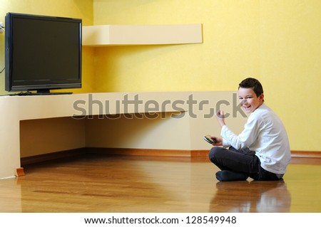 Young Boy Playing With Game Console - stock photo