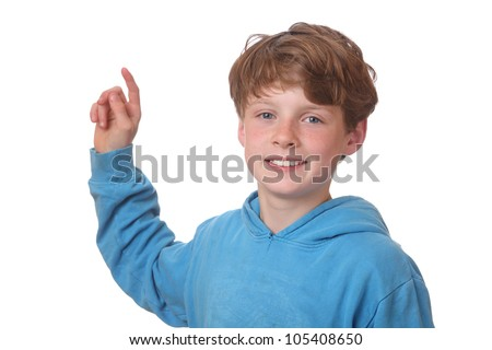 Young boy pointing index finger up on white background - stock photo