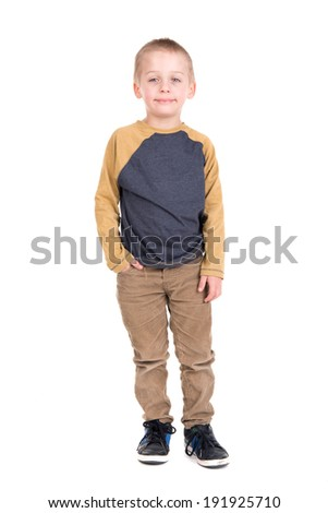 Young boy posing isolated in white