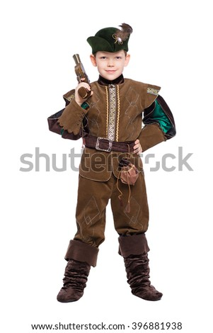 Young boy posing with a gun in the suit of medieval hunter. Isolated on white - stock photo