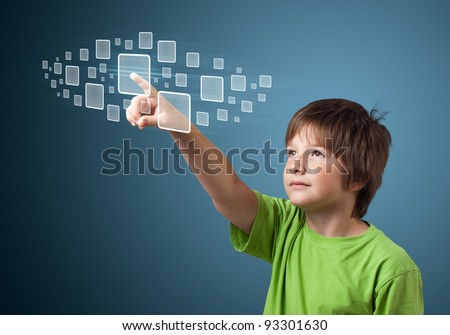 Young boy pressing high tech type of modern buttons on a virtual background