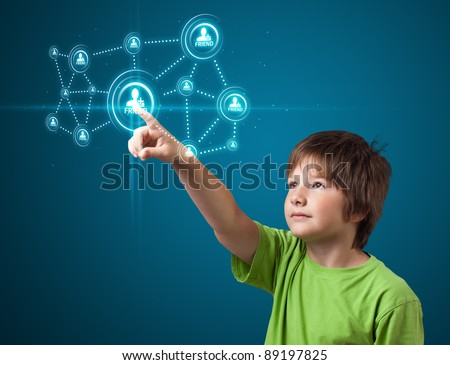 young boy pressing modern social buttons on a virtual background - stock photo
