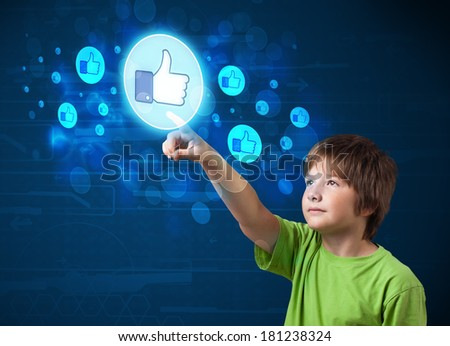 Young boy pressing thumbs up button on modern social network system - stock photo