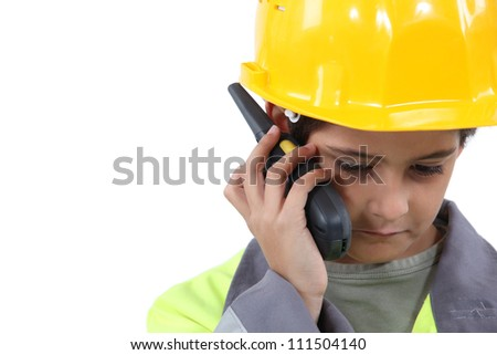 Young boy pretending to be a construction worker