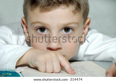 Young Boy Reading a Book - stock photo