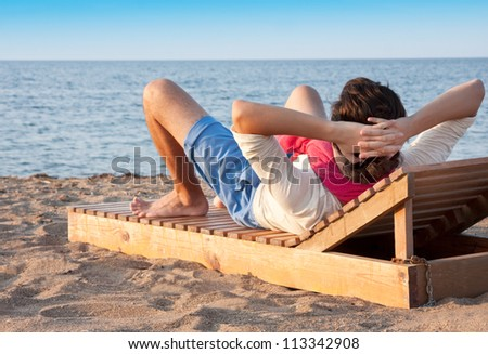 Young boy resting at beach - stock photo