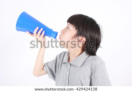 Young boy shouts into the megaphone