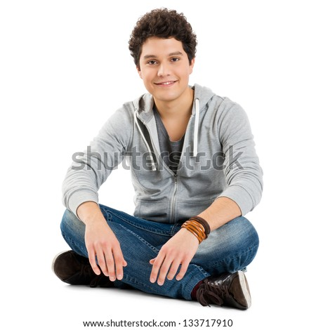 Young Boy Sitting Isolated On White Background - stock photo