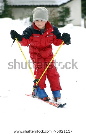young boy skiing downhill