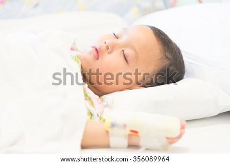 Young boy sleep and sickness stay in hospital - selective focus point