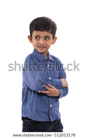 Young boy smiling and posing at studio as a fashion model on White background
