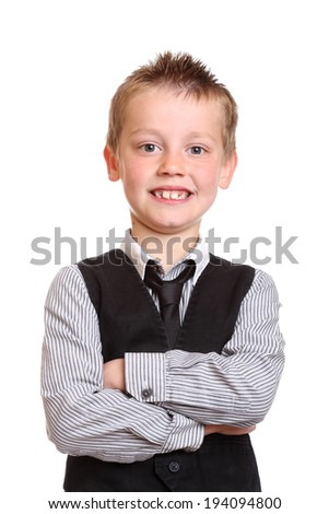 Young Boy Smiling at Camera with arms crossed - stock photo