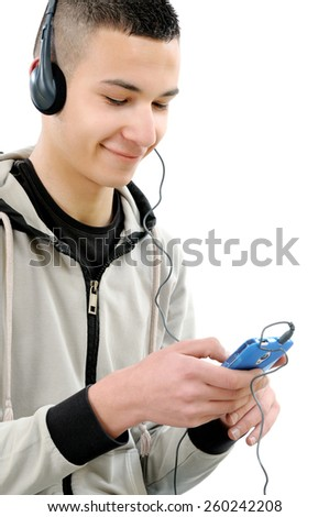 Young boy smiling with his beard listening to music on headphones from a smartphone, photo on white background. - stock photo