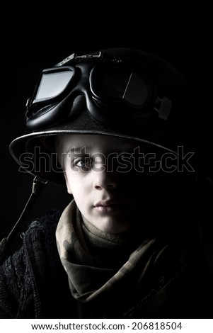 Young boy soldier portrait - stock photo