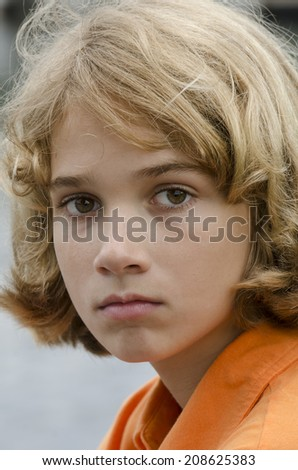 young boy staring into the camera lens
