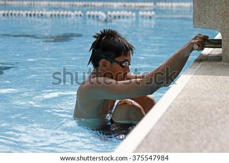 Young boy start of backstroke swimming. - stock photo