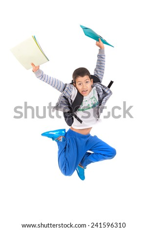 Young boy student jumping isolated in white - stock photo