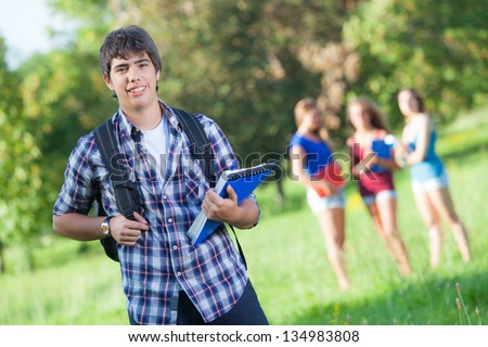 Young Boy Student with Friends at Park - stock photo